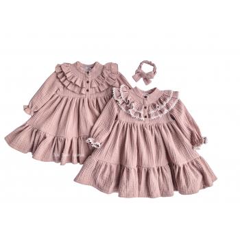 Muslin dress with a ruffle